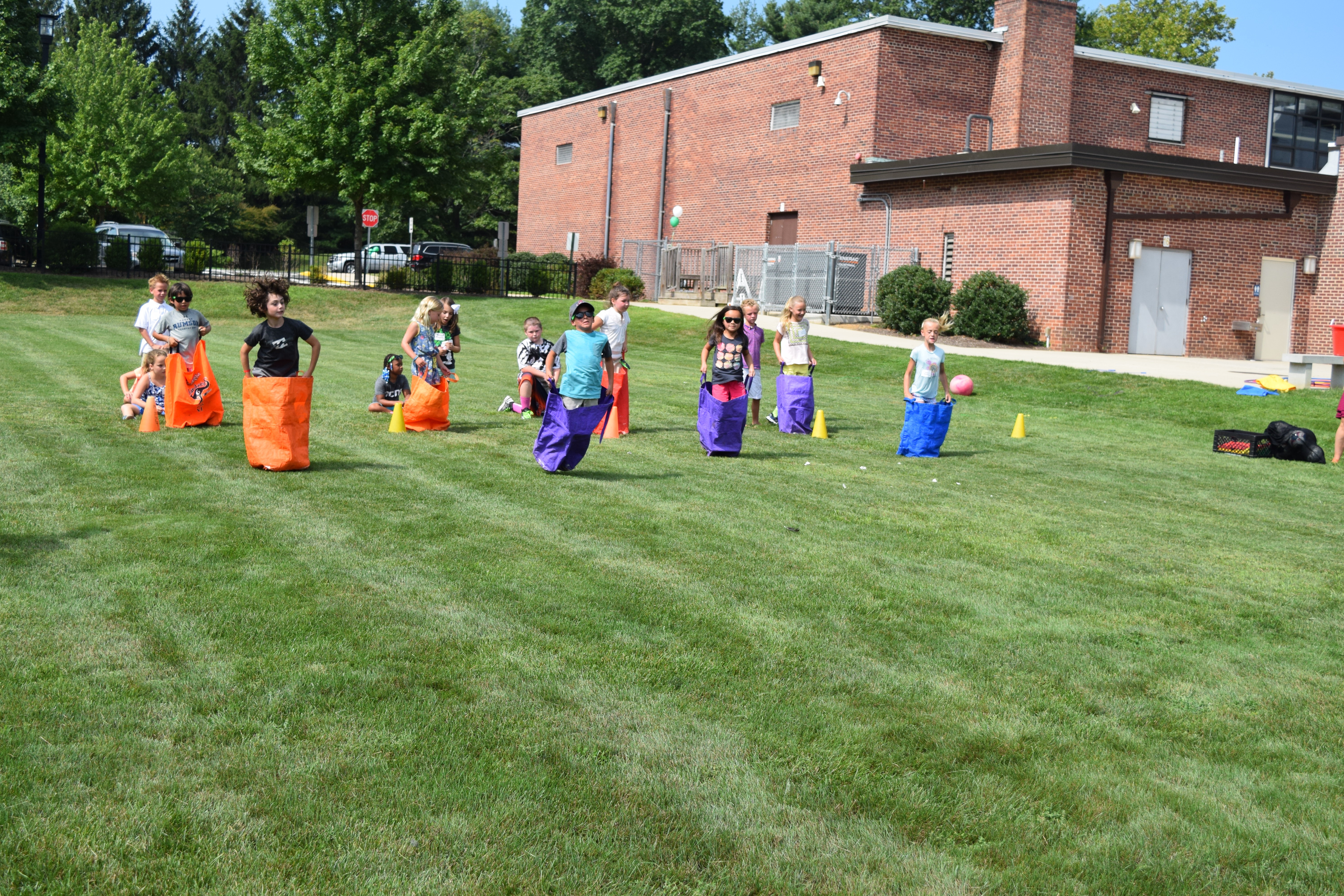 Students on a field in a potato sack race