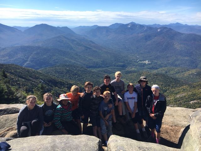 A group of students on a mountaintop