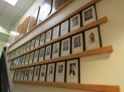 A wall of framed pictures